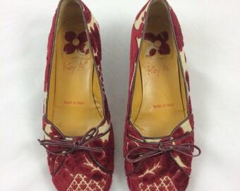 Brocade ballerina slipper with kitten heel.