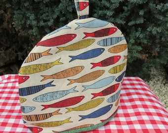 Fish.  A large tea cosy.  To fit a 4 - 5 cup teapot.