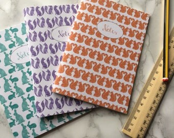 Set of 3 A6 woodland plain paper notebooks, rabbit, fox and squirrels