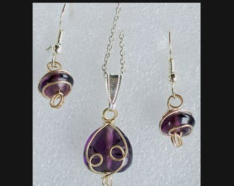 Purple stone with gold swirls necklace and earring set