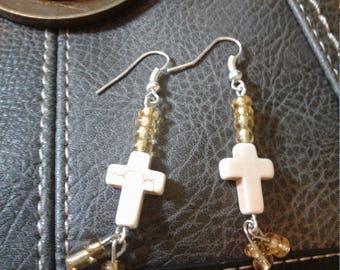 Golden cross dangle earrings