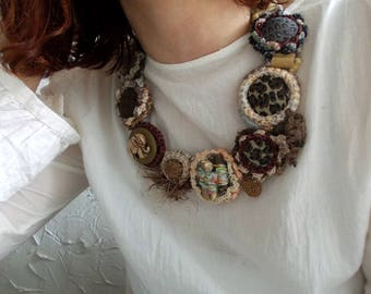 Africa...Wild Charm of Exotic Places..Crochet bib necklace with handmade  textile buttons...Small Elephant...Tribal necklace.