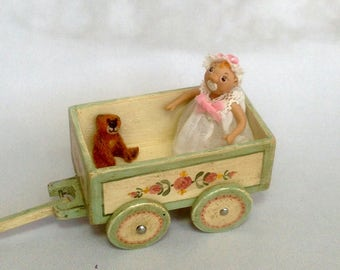 Toy cart with articulated doll and mini teddy bear. Hand painted. Scale 1:12.