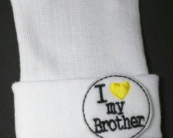 """Newborn Hospital Hat. Perfect for Pregnancy Announcement! Newborn Hospital Beanie. White  Hat with """"I 'yellow heart' my Brother"""" Exclusive!"""
