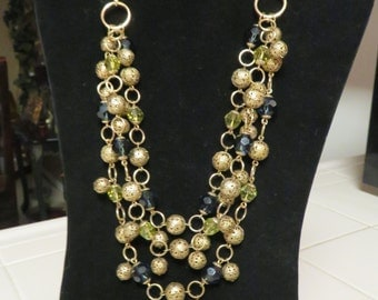 Gorgeous Vintage Gold Multi Strand Gold Metal Bead Necklace Accented With Blue And Light Green Acyrilic Beads