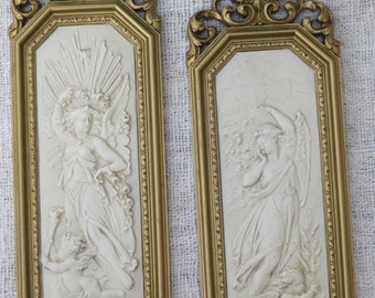 Pair of Vintage Syroco Gold Wall Plaques with Goddess and Cherub Design