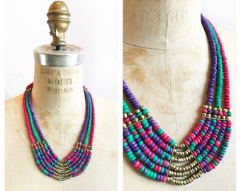 Funky pink, teal and purple bib necklace with brass beading.