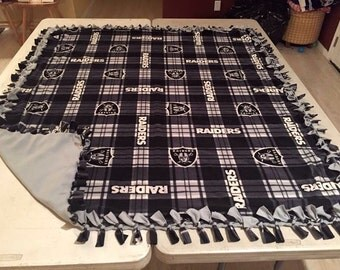 Double sided, hand tied fleece raider blanket.