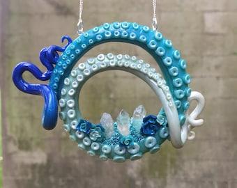 Frozen inspired tentacle pendant.