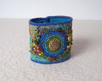 Beautiful bracelet embroidered and decorated with beads, a  eye-catcher