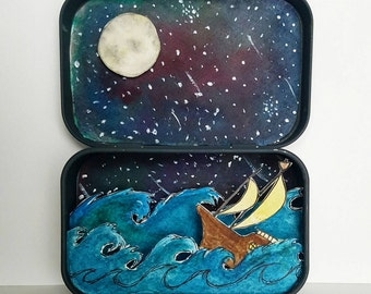 Stormy Seas - a hand drawn, painted and cut paper diorama/shadow box.