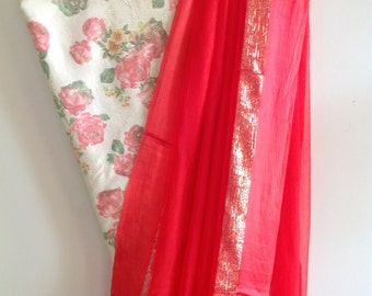 Chilli red chiffon saree with gold zari border and cream and gold floral  blouse
