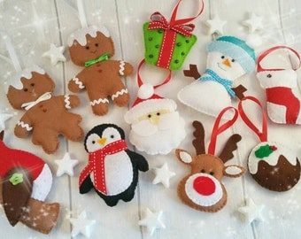 Felt Christmas decorations, Father Christmas, Snowman, gingerbread man/woman, reindeer, pudding, present, robin, stocking and penguin