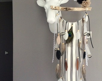 Dream catcher with driftwood and natural feathers