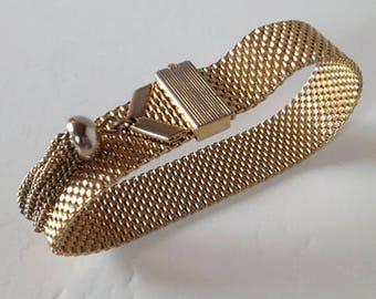 1950s Goldtone mesh bracelet with metal tassel