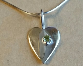 Heart w/ Peridot set in Sterling Silver with chain.