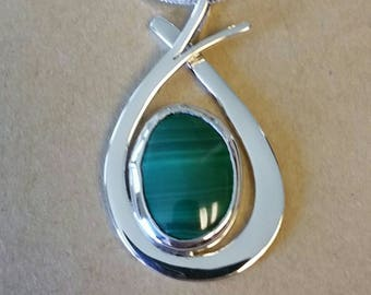 Malachite cabachon presented in a Sterling Silver pendant.