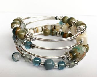 Earth tone blue gray memory wire bracelet with silver tubing
