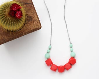 Silicone Teething Necklace for Mom - Nursing & Babywearing Distraction Necklace – Coral +  Mint Geo BPA free Chew Beads – Baby Shower Gift
