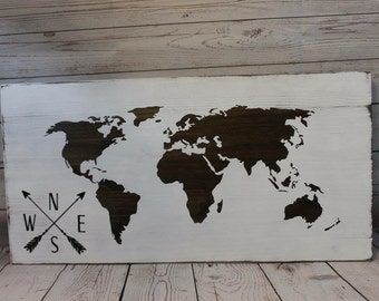 World map with arrow compass sign