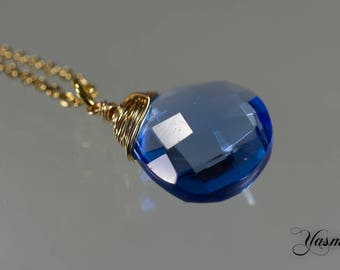 Sparkling blue to gold-plated silver chain