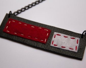 Black, red and white rectangular pendant necklace