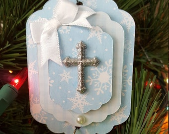 Small powder blue Christmas ornament with silver glitter cross