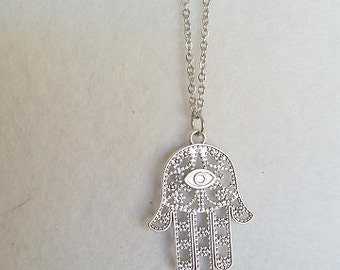 Hamsa pendant on necklace