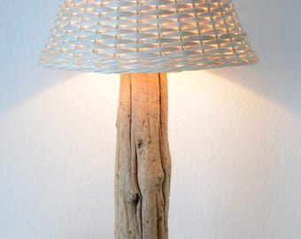 Table lamp from driftwood with shade made of rattan netting