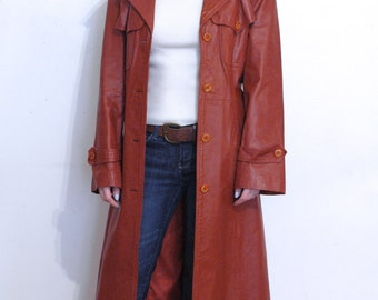 rust colored leather belted trench coat  M