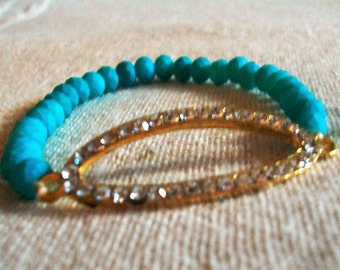stretch blue beaded bracelet with pave element