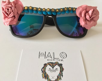 Flower embellished sunglasses with trim. Bohemian festival shades