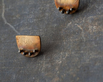 organic halfmoon riveted earrings, oxidised textured brass and sterling silver riveted modernist stud earrings