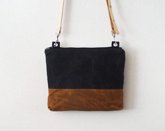 Waxed canvas crossbody bag with zipper and vegetable tanned leather strap