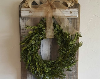 Rustic, hand crafted wreath made of boxwood or cedar tips