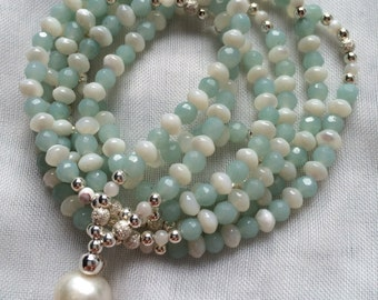Mala from Amazonite (faceted) and mother of Pearl, adorned with silver, with a Freshwater Pearl as the final Pearl
