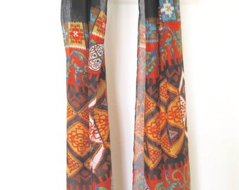 tribal black and orange patterned scarf