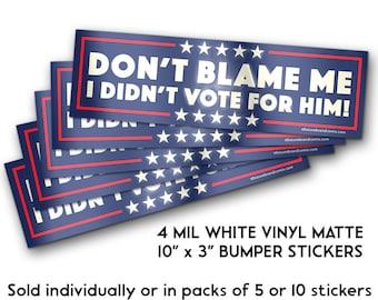 "DON'T BLAME ME - I Didn't Vote For Him! - 4 Mil 10"" x 3"" White Vinyl Matte Bumper Stickers"