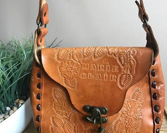 Vintage 1970s tooled leather saddle bag // 70s floral tooled leather purse shoulder strap // distressed leather purse tooled flowers boho