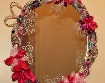 Decorative Mirror, bejewelled with beads, pearls, rhinestones, jewerly, buttons, bows, crystals and handmade satin/organza flowers.
