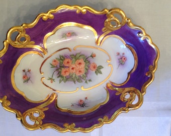 Roses,  Orange in a purple bowl trimmed with gold