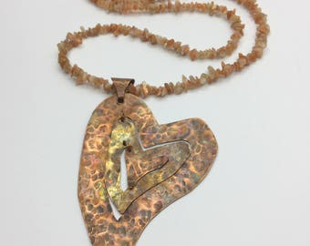 "Hammered and flame coloured copper hearts on a 36"" sunstone necklace"