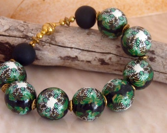 Handmade white, green, black and gold polymer clay bead bracelet