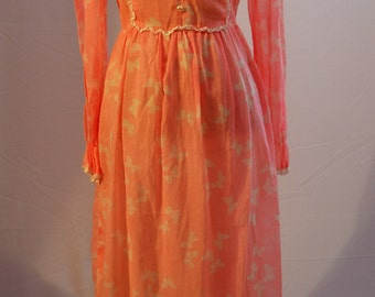 1970s steampunk Victorian style dress with butterfly pattern high collar and frill cuffs