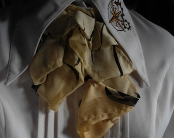 pale yellow and black fabric jabot