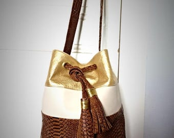 Bag bucket camel and gold shiny with PomPoms