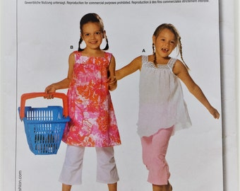 Burda sewing pattern 9580 - Girl's top and dress size 18 months - 7 years