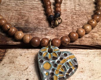 Ceramic heart pendant with polished rosewood beaded necklace