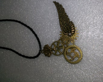 Steam punk necklace. Leather strap holding winged cogs.