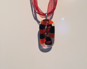 Sparkly red and black fused glass pendant